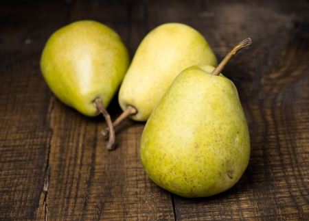 Group of pears on wood photo