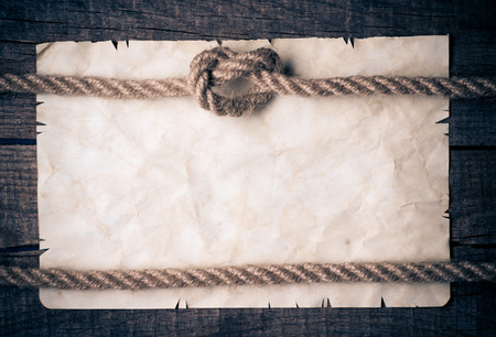 Ropes and old vintage ancient paper background  Stock Photo
