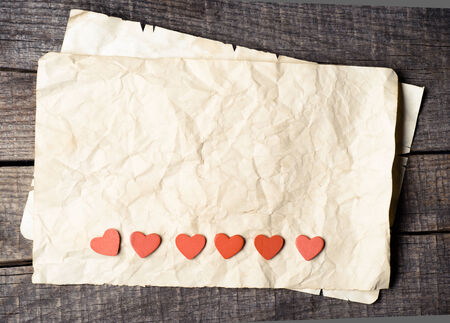Wooden heart on old paper  Stock Photo