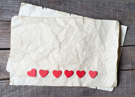 Wooden heart on old paper  photo
