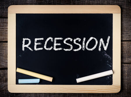 Blackboard Showing Recession on wooden background  Stock Photo