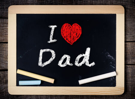 I love Dad written with chalk on the school blackboard on wood background  Stock Photo