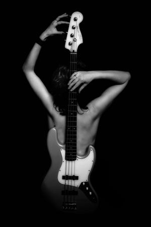 naked woman with bass gitar Stock Photo