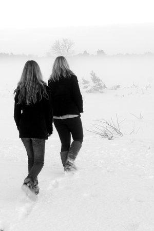 Girls walking in the snow