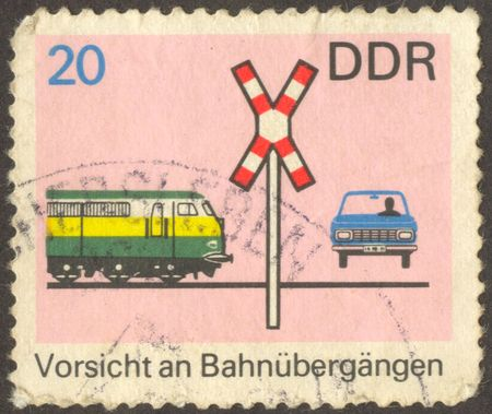 cross ties:  The scanned stamp. German stamp. The car on a railway crossing. Stock Photo