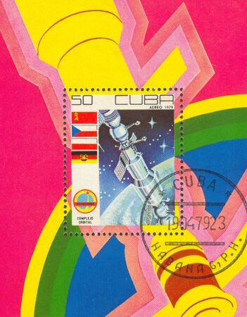 The first Cuban cosmonaut. The scanned stamp. Planet the Earth. photo