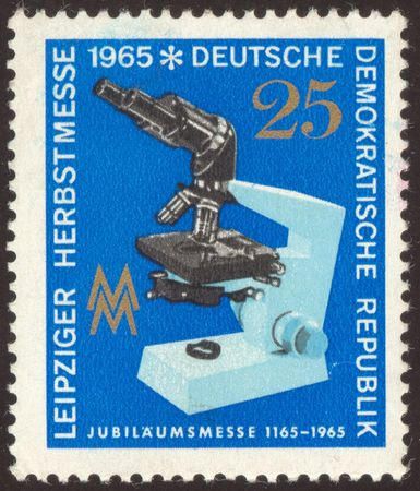 researches: The scanned stamp. German stamp. Microscope in laboratory. Biological researches.