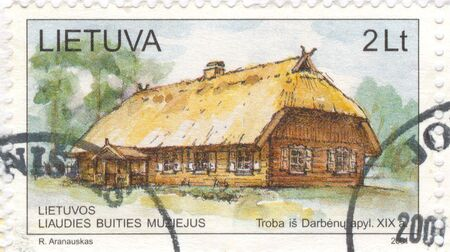 The scanned stamp. The Lithuanian stamp. The house in the Lithuanian villages. photo
