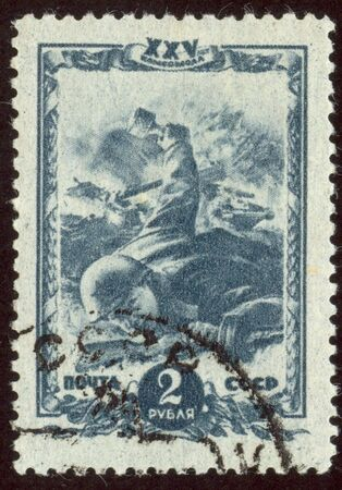 The scanned stamp. The Soviet stamp. The soldier throws a grenade. photo