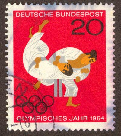 olympiad: GERMANY -CIRCA 1964: Struggle of two sportsmen, circa 1964.
