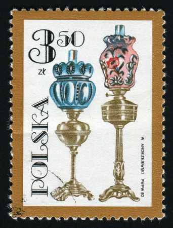 devised: POLAND -CIRCA 1982: Ignacy Lukasiewicz was a Polish pharmacist of armenian origin, who devised the first method of distilling kerosene from seep oil. Various oil lamps, circa 1982.