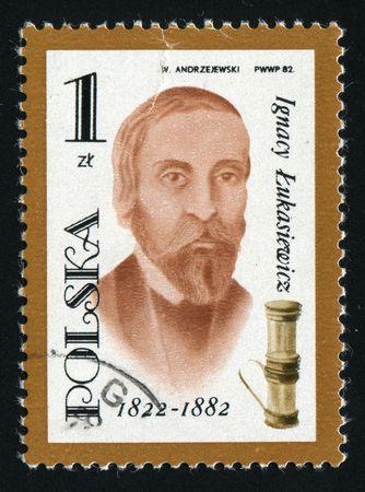 devised: POLAND -CIRCA 1982: Ignacy Lukasiewicz was a Polish pharmacist of armenian origin, who devised the first method of distilling kerosene from seep oil, circa 1982.