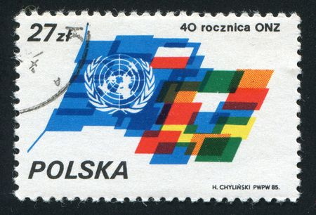 facilitating: POLAND - CIRCA 1985: The United Nations is an international organization whose stated aims are facilitating cooperation in international law, international security, economic development, circa 1985. Editorial