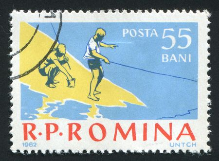 ROMANIA - CIRCA 1962: Fishing on the river. Various Fishing Scenes, circa 1962. photo