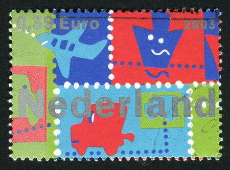 postoffice: NETHERLANDS - CIRCA 2003: Stamp of the Netherlands with an abstract. Land, Air and Water, circa 2003. Stock Photo