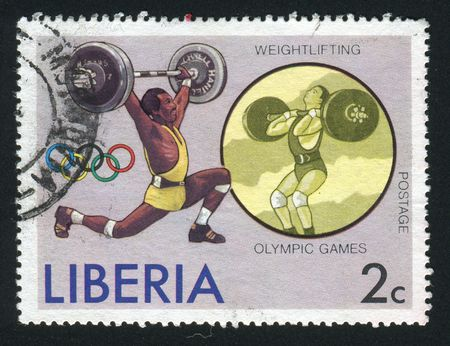 LIBERIA - CIRCA 1976: Weight Lifting and Olympic Rings, circa 1976.