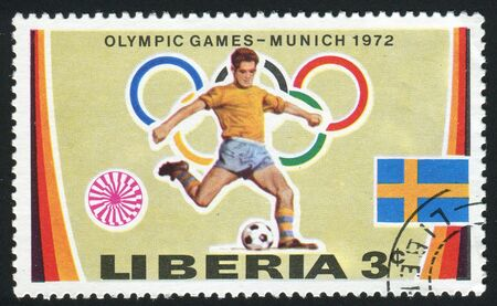 olympic symbol: LIBERIA - CIRCA 1972: Olympic Rings, �Motion� Symbol and: Soccer and Swedish Flag, circa 1972.
