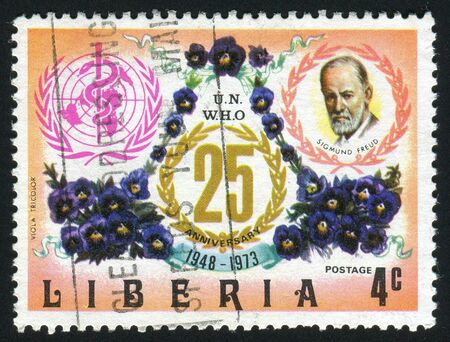 LIBERIA - CIRCA 1973: WHO Emblem, Sigmund Freud and pansies, circa 1973.