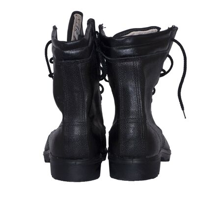 travelled: High resolution image. Black, leather, military boots on a white background.
