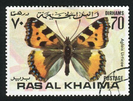 khaima: RAS AL KHAIMA - CIRCA 1978: Aglais urticae is a well-known colourful butterfly, found in temperate Europe, circa 1978.