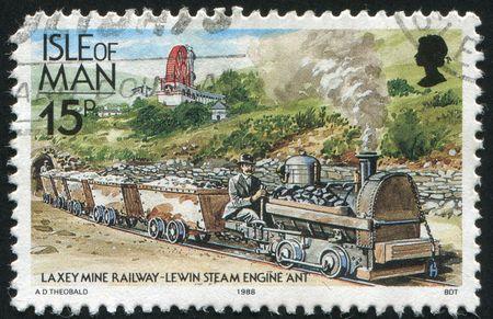 ISLE OF MAN  - CIRCA 1988: Great Laxey Mine Railway Lewin steam engine Ant pulling coal cars, circa 1988. photo