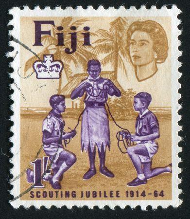 scouts: FIJI - CIRCA 1964: Scouts of India FIJI  and Europe Tying Knot, circa 1964. Editorial
