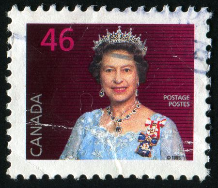 regnant: CANADA - CIRCA 1995: Elizabeth II is the queen regnant of sixteen independent sovereign states, circa 1995.