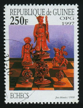 chellange: GUINEA - CIRCA 1997: Old chess China, circa 1997.