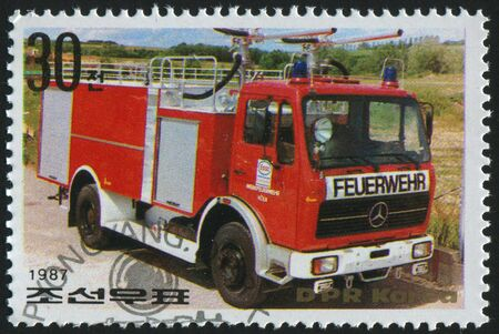 KOREA - CIRCA 1987: stamp printed by Korea,  shows  firetruck, circa 1987. photo