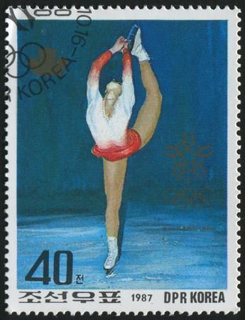 KOREA - CIRCA 1987: stamp printed by Korea,  shows women figure skate, circa 1987.