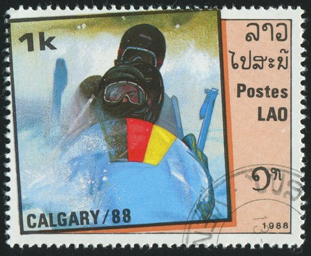 bobsled: LAOS - CIRCA 1988: stamp printed by Laos, shows bobsled, circa 1988. Stock Photo