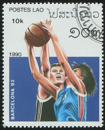 LAOS - CIRCA 1990: stamp printed by Laos, shows basketball, circa 1990.