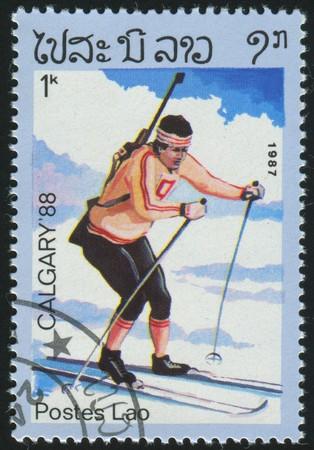 ancient olympic games: LAOS - CIRCA 1987: stamp printed by Laos, shows biathlon, circa 1987. Editorial