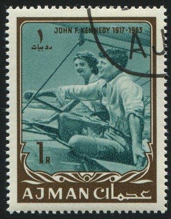 ajman: AJMAN - CIRCA 1963: stamp printed by Ajman, shows John Fitzgerald Kennedy was the 35th President of the United States, circa 1963.