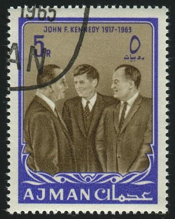 john fitzgerald kennedy: AJMAN - CIRCA 1963: stamp printed by Ajman, shows John Fitzgerald Kennedy was the 35th President of the United States, circa 1963.