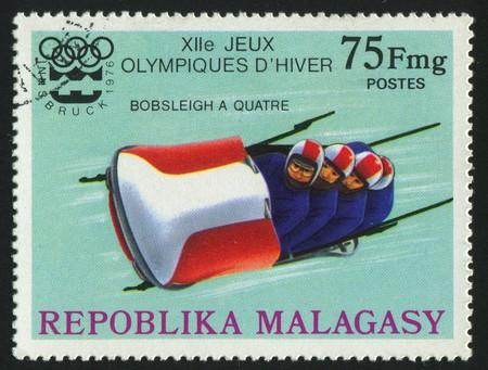 bobsled: MALAGASY - CIRCA 1976:   stamp printed by Malagasy, shows bobsled, circa 1976.