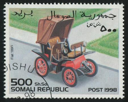 somali: SOMALI - CIRCA 1998: stamp printed by Somali, shows retro car, circa 1998. Stock Photo