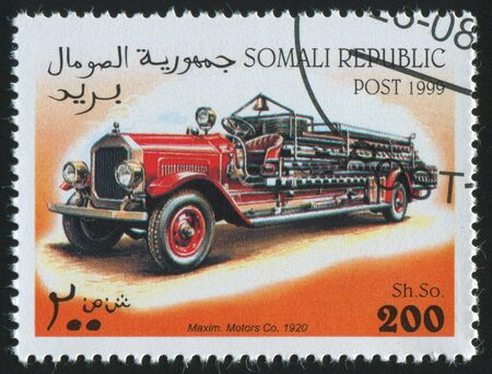 SOMALI - CIRCA 1999: stamp printed by Somali, shows retro car, circa 1999. photo