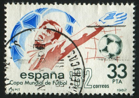 SPAIN - CIRCA 1982: stamp printed by Spain, shows soccer players and ball, circa 1982.