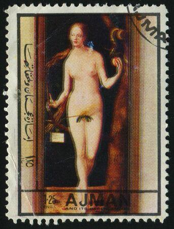 postoffice: AJMAN - CIRCA 1972: Eve with an apple in gardens Eden, circa 1972.