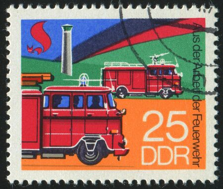 GERMANY - CIRCA 1977: stamp printed by Germany, shows retro firetruck, circa 1977. photo