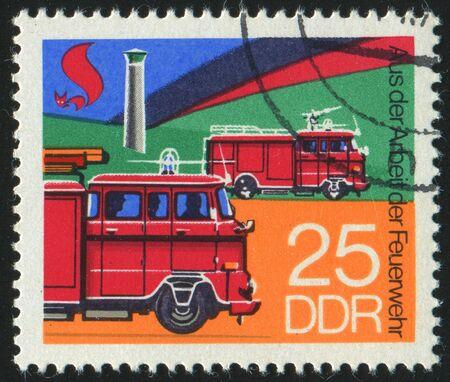 GERMANY - CIRCA 1977: stamp printed by Germany, shows retro firetruck, circa 1977. photo