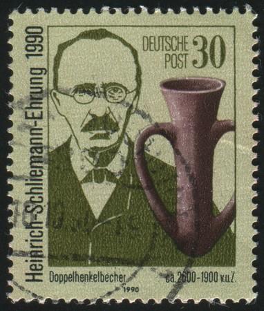 archeologist: GERMANY - CIRCA 1990: stamp printed by Germany, shows Heinrich Schliemann, circa 1990.