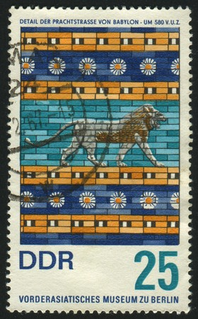 facing right: GERMANY - CIRCA 1966: stamp printed by Germany, shows Lion facing right and ornaments, Babylon, circa 1966.