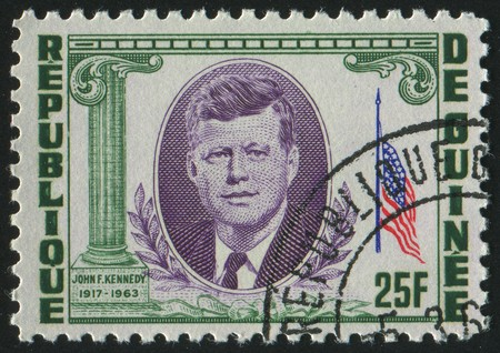 john fitzgerald kennedy: GUINEA - CIRCA 1964: stamp printed by Guinea, shows John Fitzgerald Kennedy was the 35th President of the United States, circa 1964. Editorial