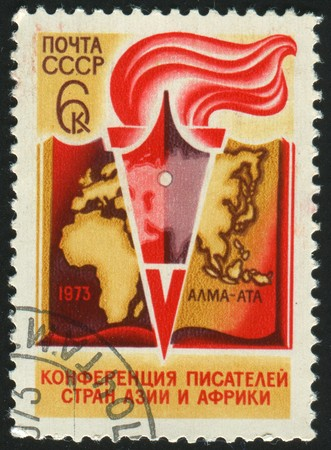 stamp printed by Russia, shows Book, Pen and Torch, circa 1973. photo