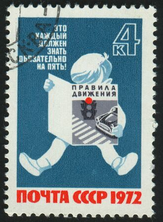 RUSSIA - CIRCA 1972: stamp printed by Russia, shows Child Reading Traffic Rules, circa 1972. photo