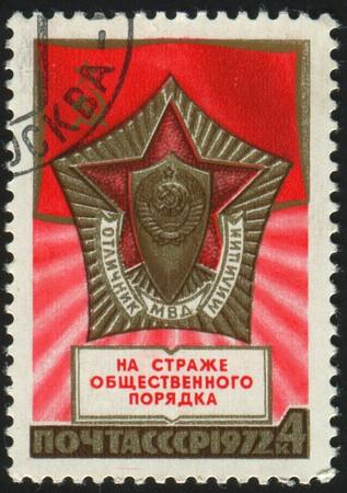 militia: stamp printed by Russia, shows Militia Badge, circa 1972.