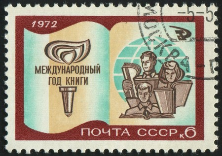 stamp printed by Russia, shows Book Torch Children and Globe, circa 1972. photo