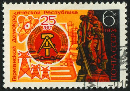 treptow: RUSSIA - CIRCA 1974: stamp printed by Russia, shows Arms of DDR and Soviet War memorial, Treptow, circa 1974.
